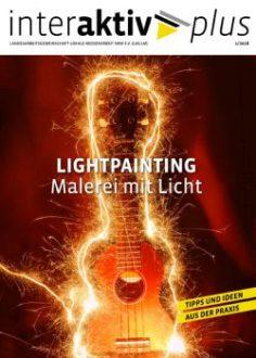 Coverseite zu Lighpainting: eine Gitarre umrundet mit Lichteffekten